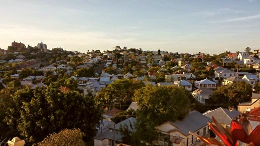 Queenslanders climbing over Red Hill